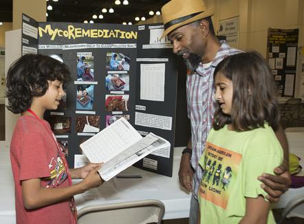Student explaining to family